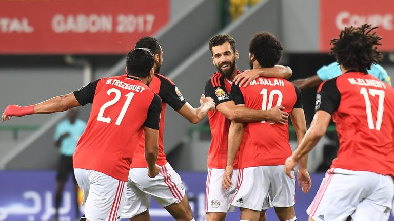 Egypt's forward Mohamed Salah (C-R) celebrates with teammates after scoring