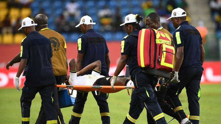Ghana's defender Baba Rahman is carried off the pitch against Uganda