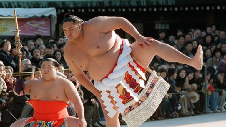 Akebono is 550lb - Neville weighs 194!