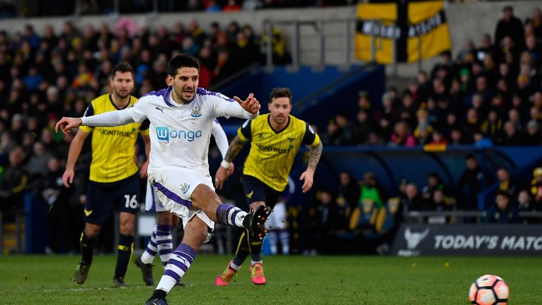 Aleksandar Mitrovic of Newcastle United misses a penalty against Oxford United