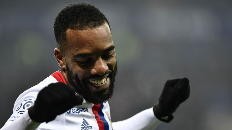 Lyon's French forward Alexandre Lacazette (L) celebrates after scoring a goal during the French L1 football match Olympique Lyonnais (OL) vs Marseille (OM)