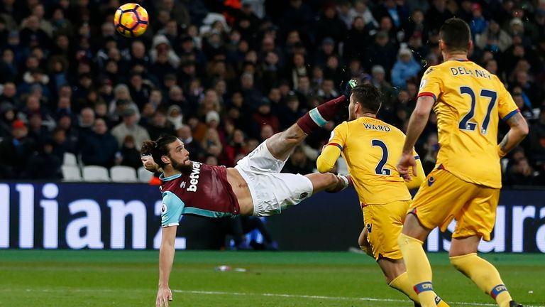 West Ham United's English striker Andy Carroll shoots to score their second goal with this bicycle kick during the English Premier League football match be