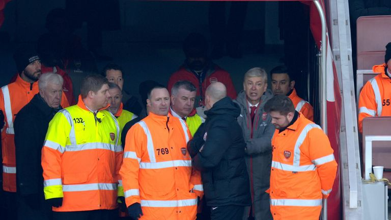 Arsene Wenger appeared to push fourth official Anthony Taylor against Burnley
