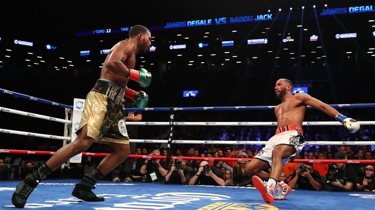 NEW YORK, NY - JANUARY 14:  Badou Jack knocks down James DeGale in the twelfth round during their WBC/IBF Super Middleweight Unification bout at the Barcla