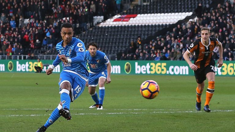 HULL, ENGLAND - JANUARY 14: Junior Stanislas of AFC Bournemouth celebrates scoring his sides first goal from the penalty spot during the Premier League mat