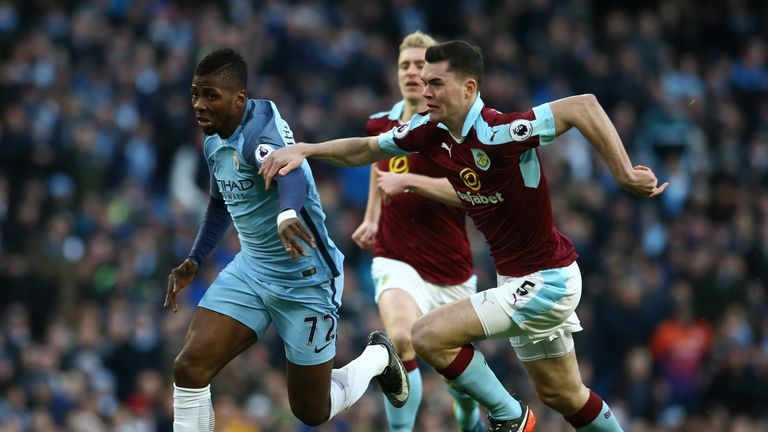Kelechi Iheanacho of Manchester City is challenged by Burnley's Michael Keane