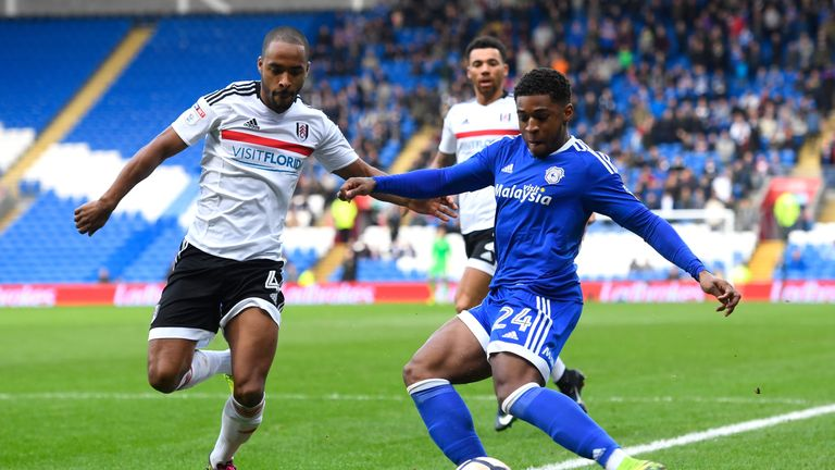 CARDIFF, WALES - JANUARY 08:  Dennis Odoi of Fulham closes down Kadeem Harris of Cardiff City during The Emirates FA Cup Third Round match between Cardiff