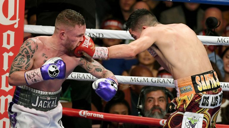 LAS VEGAS, NV - JANUARY 28:  Leo Santa Cruz (R) hits Carl Frampton with a left in the 11th round of their WBA featherweight title fight at MGM Grand Garden