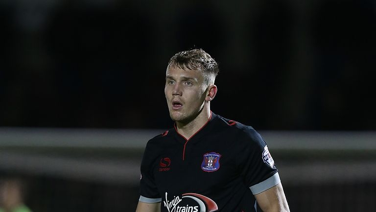 Charlie Wyke of Carlisle United in action against Northampton Town
