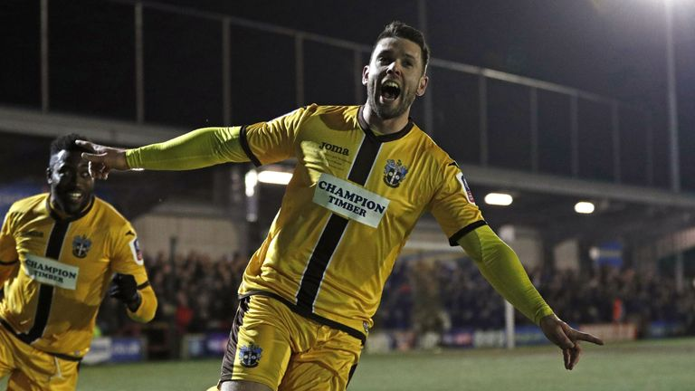 Sutton United's Dan Fitchett scored their third goal against AFC Wimbledon
