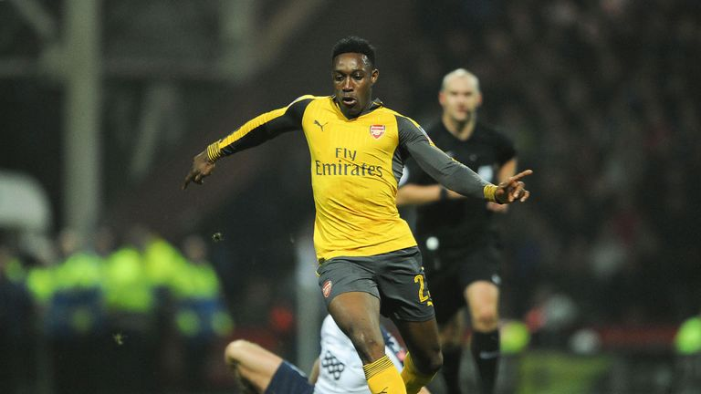 Danny Welbeck makes a run during the match between Preston North End and Arsenal at Deepdale