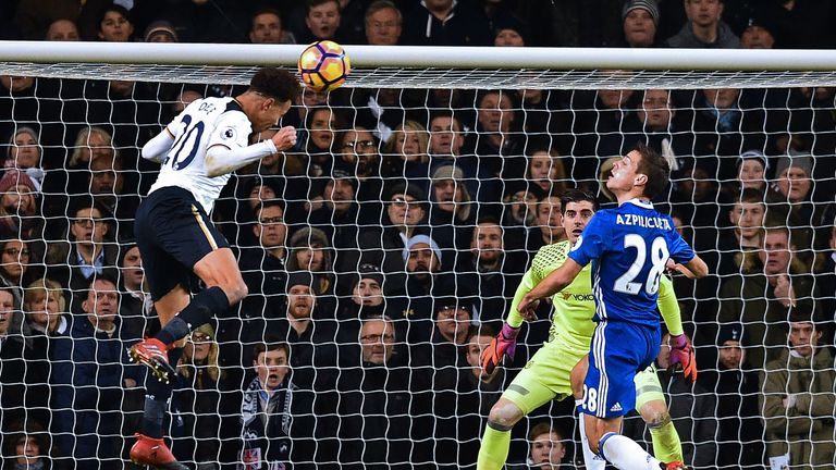 Dele Alli directs his looping header into the top corner of Thibaut Courtois' goal