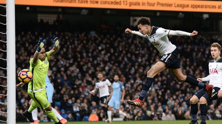 Tottenham Hotspur's English midfielder Dele Alli (2nd R) jumps to head their first goal past Manchester City's Chilean goalkeeper Claudio Bravo (L) during