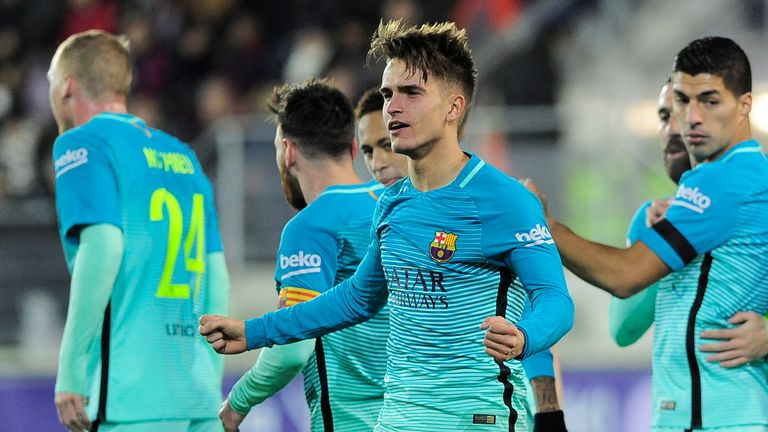 Denis Suarez (C) celebrates after scoring the opener for Barcelona - his first goal for the club