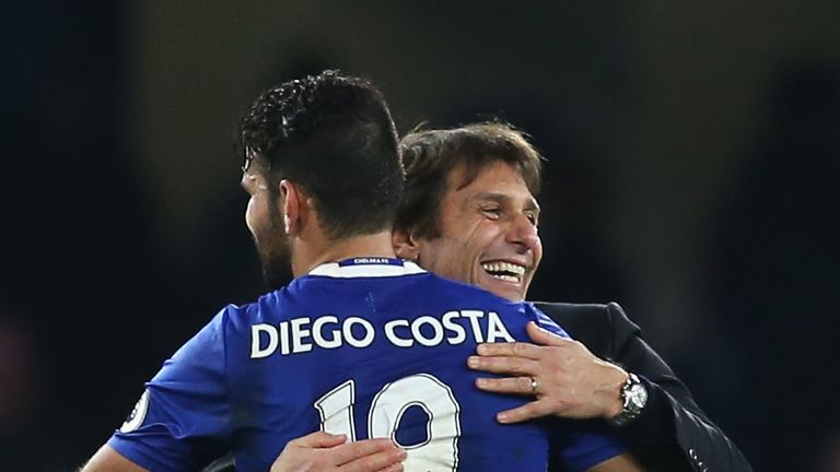 Antonio Conte embraces Chelsea striker Diego Costa