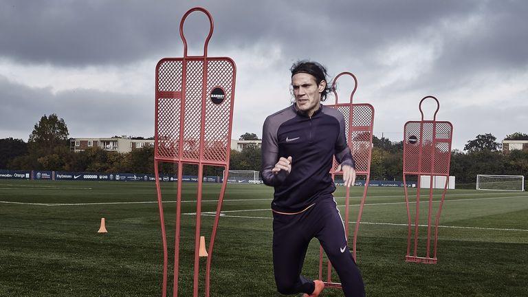 Edinson Cavani runs through a drill in Nike Football's training gear