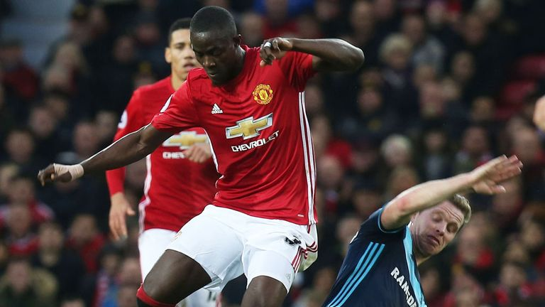 Manchester United;s Eric Bailly evades a challenge from Grant Leadbitter of Middlesbrough