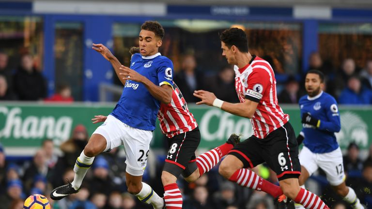 Dominic Calvert-Lewin of Everton and Jose Fonte of Southampton (R) battle for possession