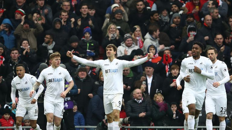 Swansea striker Fernando Llorente (C) scored twice at Anfield