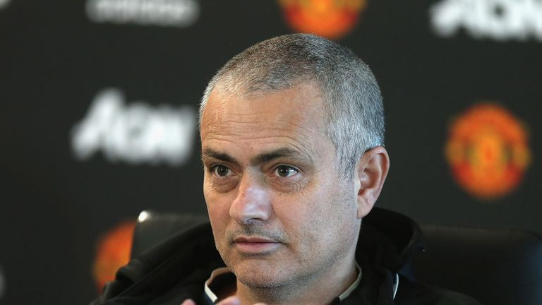 Jose Mourinho, sporting a new haircut, speaks during a press conference at Aon Training Complex