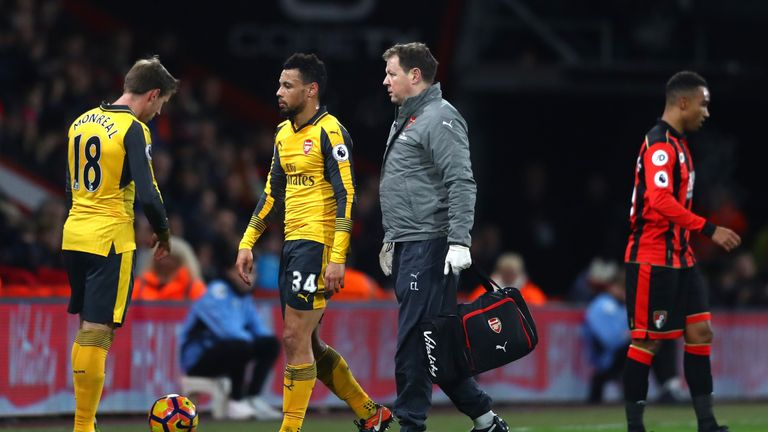 Francis Coquelin (second left) was forced off injured against Bournemouth after 28 minutes
