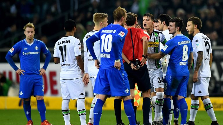 Granit Xhaka protests as he is sent off for Gladbach against Darmstadt