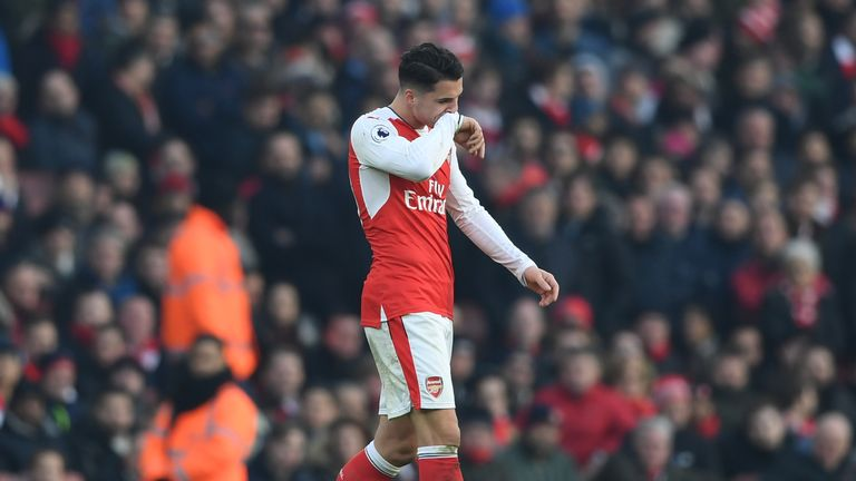 Granit Xhaka of Arsenal walks off the pitch after being shown a red card