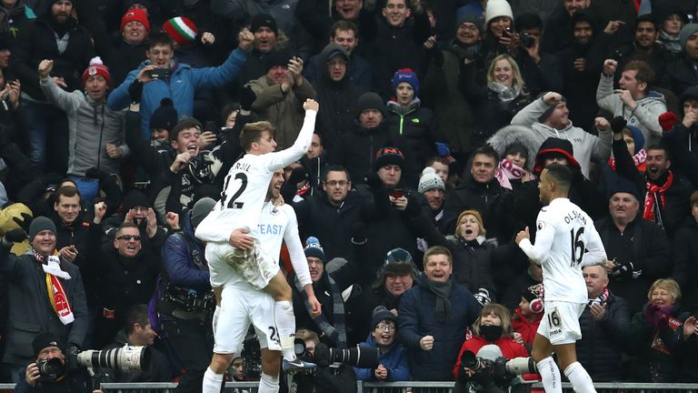 Swansea players celebrate Gylfi Sigurdsson's winner