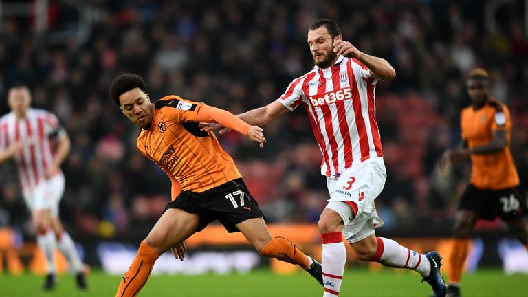 STOKE ON TRENT, ENGLAND - JANUARY 07: Helder Costa of Wolverhampton Wanderers and Erik Pieters of Stoke City compete for the ball during The Emirates FA Cu