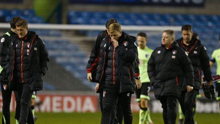 Bournemouth's English manager Eddie Howe (C) leaves the pitch after seeing his team lose 3-0 in the English FA Cup third round football match between Millw