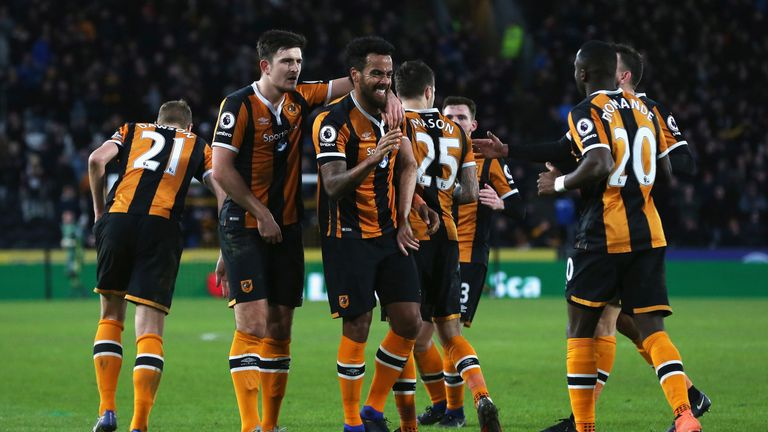 HULL, ENGLAND - JANUARY 14: Tom Huddlestone of Hull City (C) celebrates his side third goal with his Hull City team mates during the Premier League match b