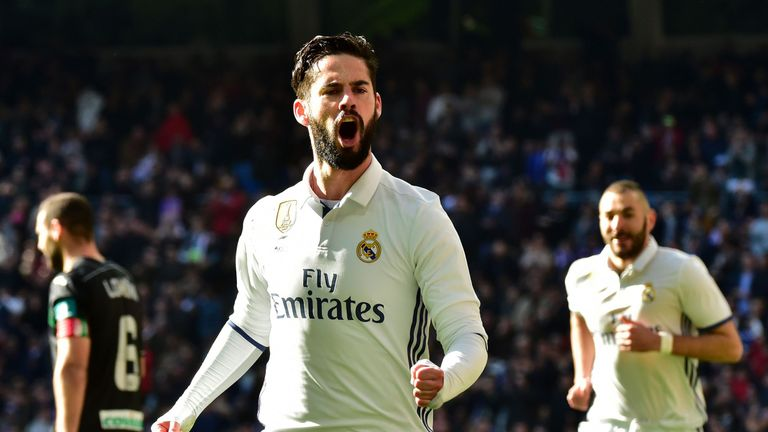 Real Madrid's midfielder Isco celebrates after scoring during the Spanish league football match Real Madrid CF vs Granada FC at the Santiago Bernabeu stadi