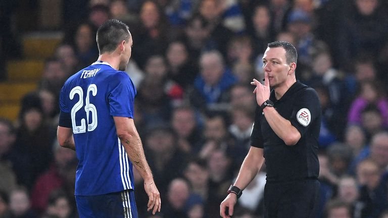 LONDON, ENGLAND - JANUARY 08:  John Terry of Chelsea is shown a red card by referee Kevin Friend during The Emirates FA Cup Third Round match between Chels