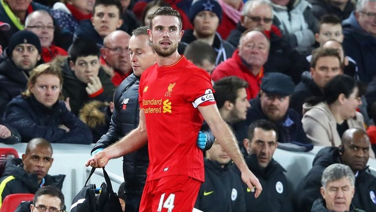 Liverpool skipper Jordan Henderson leaves the pitch after suffering injury against Manchester City