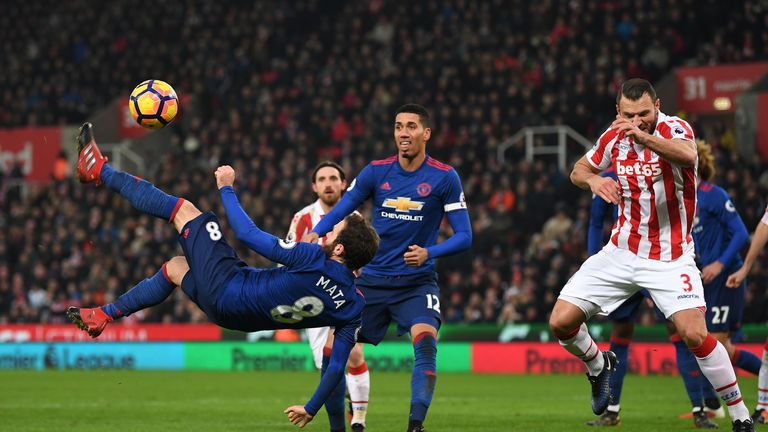Mata miscues an overhead kick attempt in the Stoke box