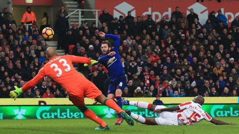 Juan Mata sends a chance over the bar against Stoke