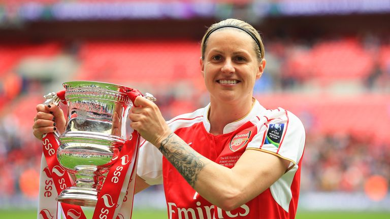 Arsenal's Kelly Smith celebrates with the the SSE Women's FA Cup after beating Chelsea in the final