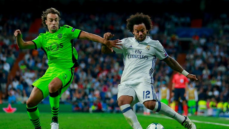 Marcelo (R) of Real Madrid CF competes for the ball with Lazar Markovic (L) of Sporting Lisbon