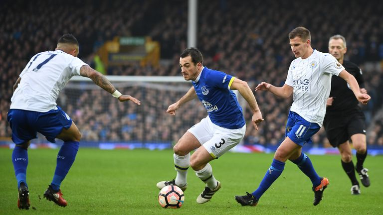 LIVERPOOL, ENGLAND - JANUARY 07: Leighton Baines (C) of Everton competes against Danny Simpson (L) and Marc Albrighton (R) of Leicester City during the Emi