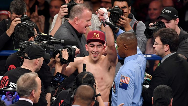 LAS VEGAS, NV - JANUARY 28:  Kenny Bayless holds up Leo Santa Cruz's hand after he was announced as the winner by majority decision in his WBA featherweigh