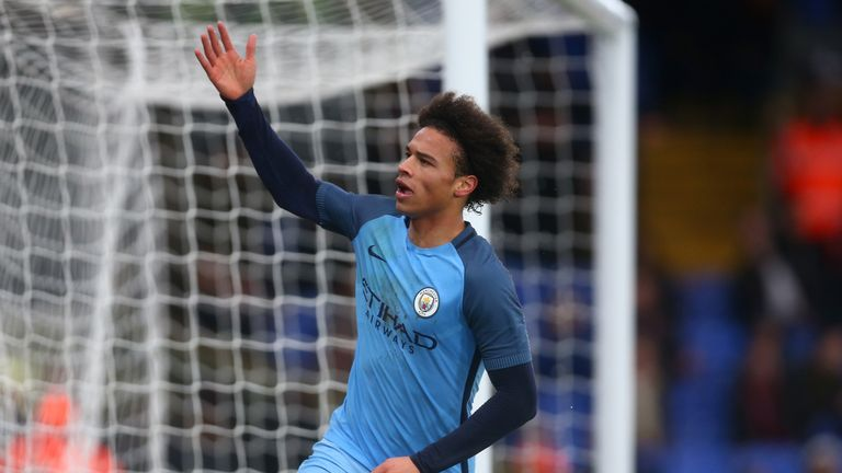 Leroy Sane of Manchester City celebrates after scoring his side's second goal against Crystal Palace