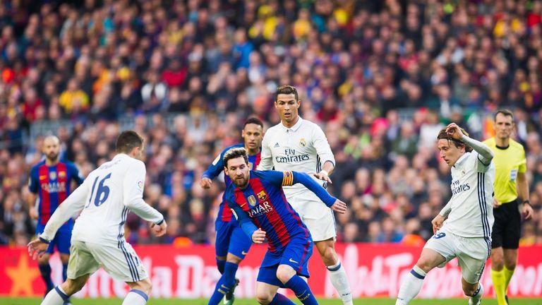 Lionel Messi looks to dribble past Mateo Kovacic, Cristiano Ronaldoand Luka Modric