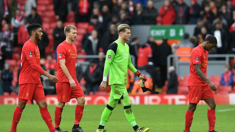 Liverpool's German goalkeeper Loris Karius (2R) leave the pitch following the English FA Cup fourth round football match between Liverpool and Wolverhampto