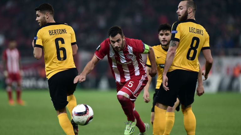 Luka Milivojevic (centre) in action for Olympiakos in the Champions League