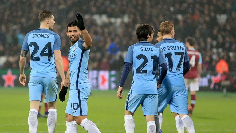 Manchester City's Sergio Aguero (second left) celebrates scoring his side's fourth goal of the game during the Emirates FA Cup, Third Round match at the Lo