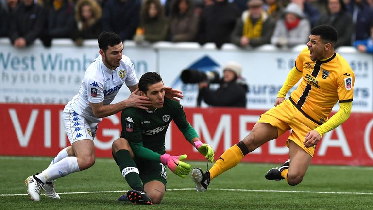 Marco Silvestri and Lewie Coyle tussle with Maxime Biamou in the incident that prompted the penalty