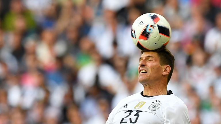 Germany's forward Mario Gomez heads the ball during the Euro 2016 round of 16 football match between Germany and Slovakia at the Pierre-Mauroy stadium in V
