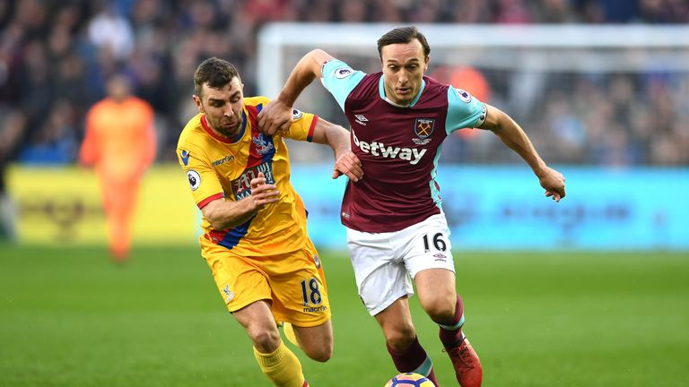 Mark Noble gets away from James McArthur