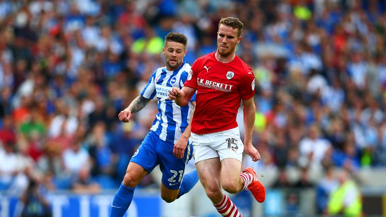 BRIGHTON, ENGLAND - SEPTEMBER 24:  Marley Watkins of Barnsley runs with the ball under pressure from Oliver Norwood of Brighton & Hove Albion during the Sk