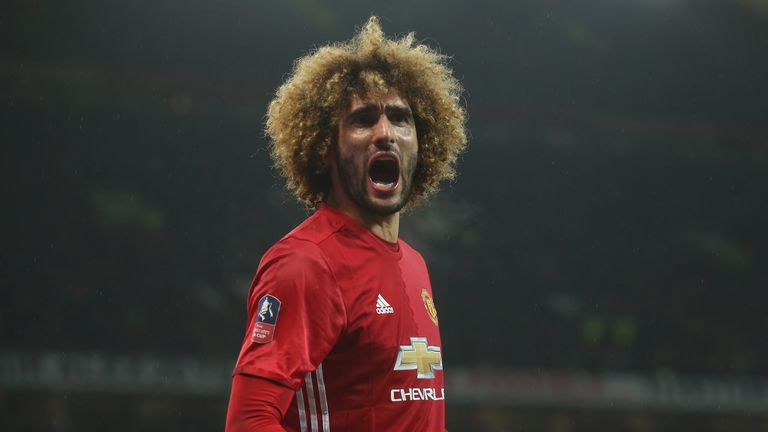 Marouane Fellaini celebrates Manchester United's opening goal against Wigan